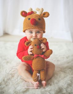 Ravelry: Reindeer Hat and Reindeer Doll pattern by Jocelyn Sass Knitted Baby Outfits, Crochet Baby Hats, Cute Crochet, Easy Crochet Patterns, Baby Patterns, Crocheting Patterns, Baby Shower Photo Props, Reindeer Hat, Holiday Crochet