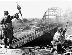 Troops from the British 1st Airborne Division and wrecked German vehicles on the northern ramp to the Arnhem Road Bridge (September 19, 1944)