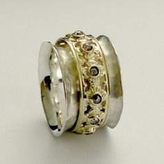 Wide 14k white gold band with a yellow gold spinner inlaid champagne diamonds - New beginning