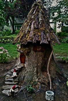 """we built a Gnome house from a tree trunk in our yard! """"Faux real by Joyce"""""""