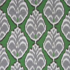 A mid-weight cotton ikat upholstery fabric in dark emerald green, charcoal grey and white. This medallion home decor fabric is suitable for all