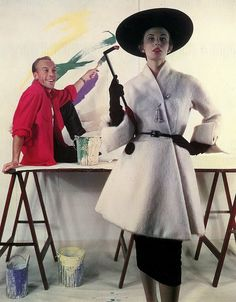 Model is wearing a white mohair asymmetrical jacket by designer Jacques Fath, who is sitting behind her. #vintage #1950s #fashion #designers #painting