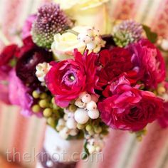 Fuchsia hydrangeas packed a bold punch, while white and green berries added a playful touch.