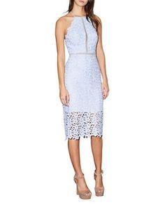 <ul> <li>Halter midi dress with lace petals and crocheted panels</li> <li>Halterneck</li> <li>Sleeveless</li> <li>Scalloped hem</li> <li>Open back with tie closure</li> <li>Concealed back zipper</li> <li>Partially lined</li> <li>Polyester</li> <li>Combo: Cotton</li> <li>Dry clean</li> <li>Imported</li> <li>This item will arrive with a tag attached and instructions for removal. Once tag is removed, this item cannot be returned.</li> </ul>