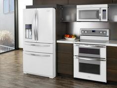 Appliances: White And Reimagined Kitchen Appliances. electrical appliances. white kitchen appliances. white refrigerator. white microwave oven. white oven. dark brown kitchen cabinet. wood flooring.