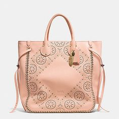 Like the shape of the bag and the laser cut outs.