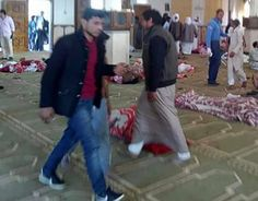 Egypt attack: Gunmen kill 235 in Sinai mosque   -  November 24, 2017.  Egyptians walk past bodies following a gun and bombing attack at the Rawda mosque, roughly 40 kilometres west of the North Sinai capital of El-Arish, on November 24, 2017.