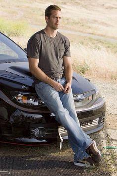 Paul walker sitting on a Subaru. Miss you!