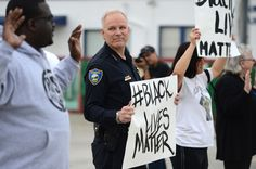"""""""Richmond, California Chief of Police Chris Magnus stands with demonstrators along Macdonald Ave. to protest the Michael Brown and Eric Garner deaths during a peaceful demonstration in Richmond, Calif., on Tuesday, Dec. 9, 2014."""""""