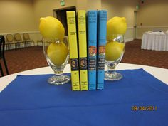 Cocktail hour table decoration.  Books were symbolic of couple and matched colors. Lemons appeared throughout.