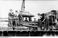 """Soldiers of 638th battery of heavy artillery load """"Ziu"""" German 600mm caliber mortar of type """"Karl"""" used for bombing of Warsaw Old Town from Sowiński Park in Wola district. Warsaw Uprising ,18 August 1944 - 21 September 1944"""