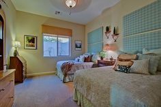 30946 N 120th Ave, Peoria, AZ 85383 - Zillow mls82822393   I'm not into the colors HOWEVER what I really like is the idea for the easy headboard that could easily take up space on my empty wall and it's much less expensive then a bed frame headboard.  Could also make a coordinating valance.hummm!!! ALSO love how the quilts have been sewn on the corners to neaten up the room - very model home style but functional!