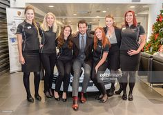 David Gandy poses with staff at The Porsche Centre Mount Street before he turns on the Mount Street Christmas lights on November 27, 2014 in London, England.