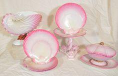 A 19th century Wedgwood dessert service painted in a fanciful bright pink with naturalistically modeled shell shaped dishes, a nautilus shell for the centerpiece, a clam shell sauce tureen, an oyster shell for the dozen dessert dishes, and dolphin form columns on the 3 oyster shell cookie plates. During 1778 and afterwards, (Josiah) Wedgwood made conchology his study, and formed an admirable collection of shells.  6.1