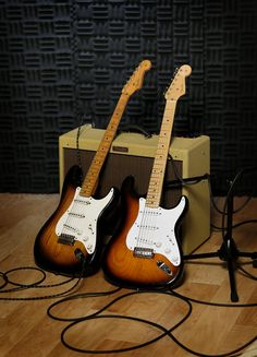 An original 1954 Fender Stratocaster, left, is shown next to a 2014 model at a studio in Scottsdale, Ariz. on Friday, Jan. 10, 2014. Leo Fender developed the instrument in a small workshop in Fullerton, Calif. six decades ago. (Photo by Matt York/AP Photo)