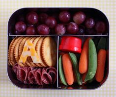"grapes - crackers - an ""A"" cut from cheese - salami - carrots and sugar snap peas #Lunchbox"