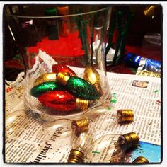 burnt out Christmas lights recycled...paint lightly with Modpodge and roll in glitter. put in a jar or hang on the tree.