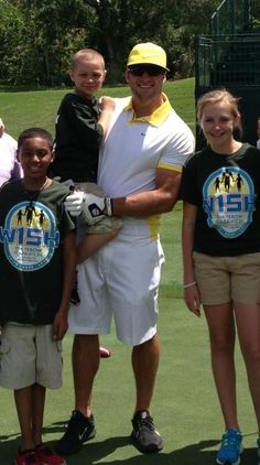 Tim Tebow Foundation Celebrity Gala & Golf Classic-- Tim spending time with W15H children...reminding everyone what the whole weekend is about. :)