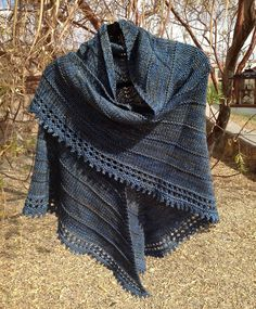 This is knitted from the boneyard shawl pattern free on Ravelry.   I used Madelinetosh vintage worn denim.. Four skeins.. Border is islet t...