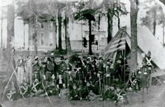 Militiamen of the 1st Regiment, Missouri State Guards, posing at Camp Lewis which was set up on fair grounds in St. Louis, Missouri, 1860.
