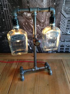 *THIS IS A MADE TO ORDER ITEM•• Steampunk Industrial Whisky Bottle Pipe Lamp  This is a made to order item. This is a previous build by The Vintage Bulb, LLC. The quantity is currently 0. If you purchase this item, please allow 1-3 weeks for construction and shipping. ****Please contact us with any questions before purchasing this item****  Featured is a handmade Steampunk Industrial Pipe Lamp. Constructed with 1/2 inch black steel pipe, two keyless chandelier light sockets with two 25 w...