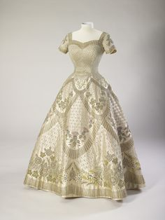 Dresses worn by The Queen for two of the most significant occasions in her life will be seen together for the first time ever at the Summer Opening of the State Rooms at Buckingham Palace. The wedding dress worn by Princess Elizabeth for her marriage to The Duke of Edinburgh on 20 November 1947, and The Queens Coronation dress, both designed by the great British couturier Sir Norman Hartnell (1901–1979) will both be on display at Buckingham Palace from Saturday, 23 July to Sunday, 2 October. ... Elizabeth Ii, Queen Elizabeth Wedding, Princess Elizabeth, Norman Hartnell, Vintage Gowns, Vintage Outfits, Queen's Coronation, Queens Wedding, Style Royal