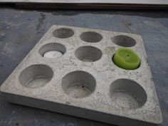 Make a beton Mancala board (african game with pebbles) - to stay out in the garden