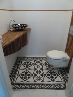 Awesome tiled floor in powder room what