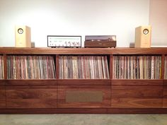 The client needed extensive and accessible storage for their impressive vinyl collection. They wanted the ability to display their stereo components, as well as to bring a little warmth into an otherwise cold room. The piece stores thousands of records on…