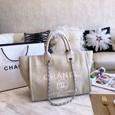 Bags Type: Single shoulder bag with two handles and shoulder strapsClosure Type: Magnetic claspMaterial: High grade PU , interior single zipper side pocket Dimensions: Strap: Metal and leather twined adjustable Chanel Tote Bag, Chanel Handbags, Dior Saddle Bag, Saddle Bags, Louis Vuitton Heels, Chanel Canvas, Kim K Style, Kendall And Kylie Jenner, Beach Tote Bags