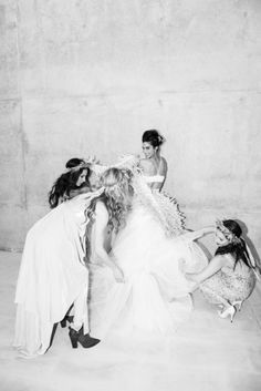Andi Potamkin stepping into her Maurizio Galante gown