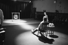 Rodney Graham, Lobbing Potatoes at a Gong, 2006, super 16mm b/w film, digital stereo sound, super 16 xenon projector with looper, amplifier, two speakers, one sub-woofer, synch electronics, bottle of potato vodka and vitrine, two paintings, print 4:20 minutes, continuous loop; painting: 154.9 x 154.9 cm; print: 55.9 x 45.1 x 3.8 cm