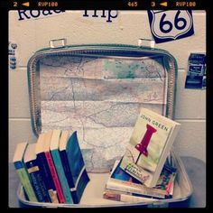 Road Trip book display!  on the road, 13 little blue envelopes, goinf bovine, paper towns, an abund of kath, walk two moons, amy & roger's epic detour, the bean trees, sisterhood of traveling pants, american gods, canterbury tales