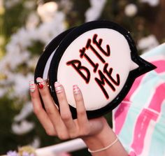 Bite me! Talk bubble clutch.