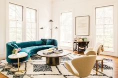 When a room's foundation is built by neutrals, it's always refreshing to see one piece that really pops. This decadent turquoise velvet couch is the perfect addition to the room, and ties all of the decor together.