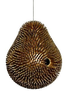 This beautiful birdhouse by L.FT may look like a carefully cast brass sculpture, but it's actually a construction made up of 2500 empty bullet shells.FT's Birdhouse is Made from 2500 Recycled Bullet Shells