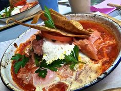 Shakshuka with hot smoked salmon and capers at Bowery to Williamsburg in Melbourne