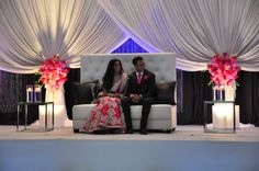 Not such a high backed couch - but similar idea ---- without the stage | Indian bride and groom at their reception