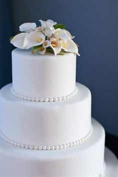 Topping your wedding cake with flowers is such a beautiful way to represent elegance. Whether they are real flowers or sugar creations, your guests will certainly appreciate their beauty.  #weddingcake #wedding #weddingflower #rosepetalevents  Photo Source: https://pixabay.com/en/blue-cake-wedding-cake-wedding-1821389/