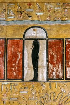 God in shrine, Book of Gates second division third hour; Wall painting and relief carving in the tomb of Seti I, KV17 in the Valley of the Kings at Thebes, Luxor...