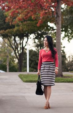 cute & little blog | fall colors outfit | red-orange top, black white striped skirt, sole society elisa, gold jewel statement necklace, celine mini luggage tote