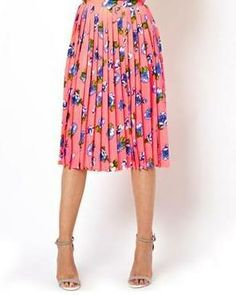 Stylist: Color crush! Love that this just covers the knees--perfect midi trend for petites like me!   A femme midi skirt for spring.