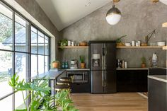 I could list so many things I love about this kitchen. The minimalistic open shelving units, and dark lower cabinets and appliances gave this space such a neat vibe. Perfect for the Wixsom family!