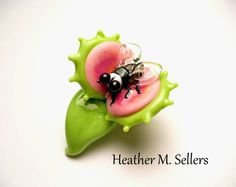 """Welcome to Paradise"" a lampwork glass sculptural bead featuring a common housefly and a venus flytrap.  Designed and flameworked by Heather Sellers."
