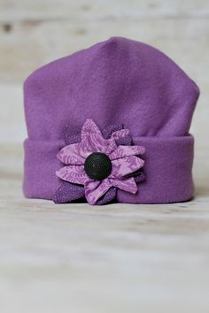 Adorable Purple Fleece hat with flower by MilliesFrillies on Etsy, $12.00