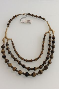 Lorren Bell Tiger Eye Necklace from . Tigers Eye Necklace, Tiger Eye Beads, Bootie Sandals, Tie Dye Dress, Hair Ornaments, Book Gifts, Floral Lace, Leggings Are Not Pants, Floral Prints