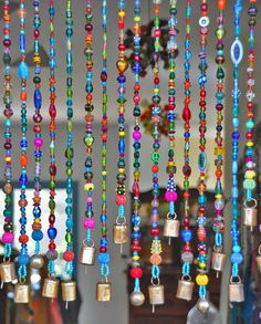 Colorful Hanging Door Beads-bead curtain-Glass Beaded Curtain-colorful Glass Beaded Suncatcher-outdoor beaded door curtain-beaded glass curtain Glass can be a powerful, versatile design choice in both the spiritual and interior design worlds. It can reflect light, incorporate color, diffuse energy, and direct the flow of energy. In Feng Shui it is representative of Water. In Western interior design it allows the designer to play with the light in the room. This colorful glass bead curtain…