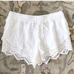White eyelet lace summer shorts Small S White eyelet lace shorts with elastic waist.  New & never worn.  Fully lined.  Listing is for a size small.  I'm modeling the Medium and wear a size 27 in jeans so I would guess the Small will fit about like a size 26 jeans or size 2. Shorts