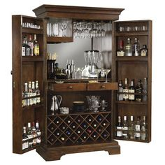 The Sonoma Wine and Bar Cabinet by Howard Miller features a raised door panel and room to store 22 wine bottles with a generous amount of room for liquor storage. Finished in Americana Cherry on select hardwoods and veneers.
