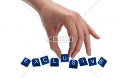 keys spelling the word exclusive - Concept shot of hand holding keyboard keys and spelling the word exclusive.
